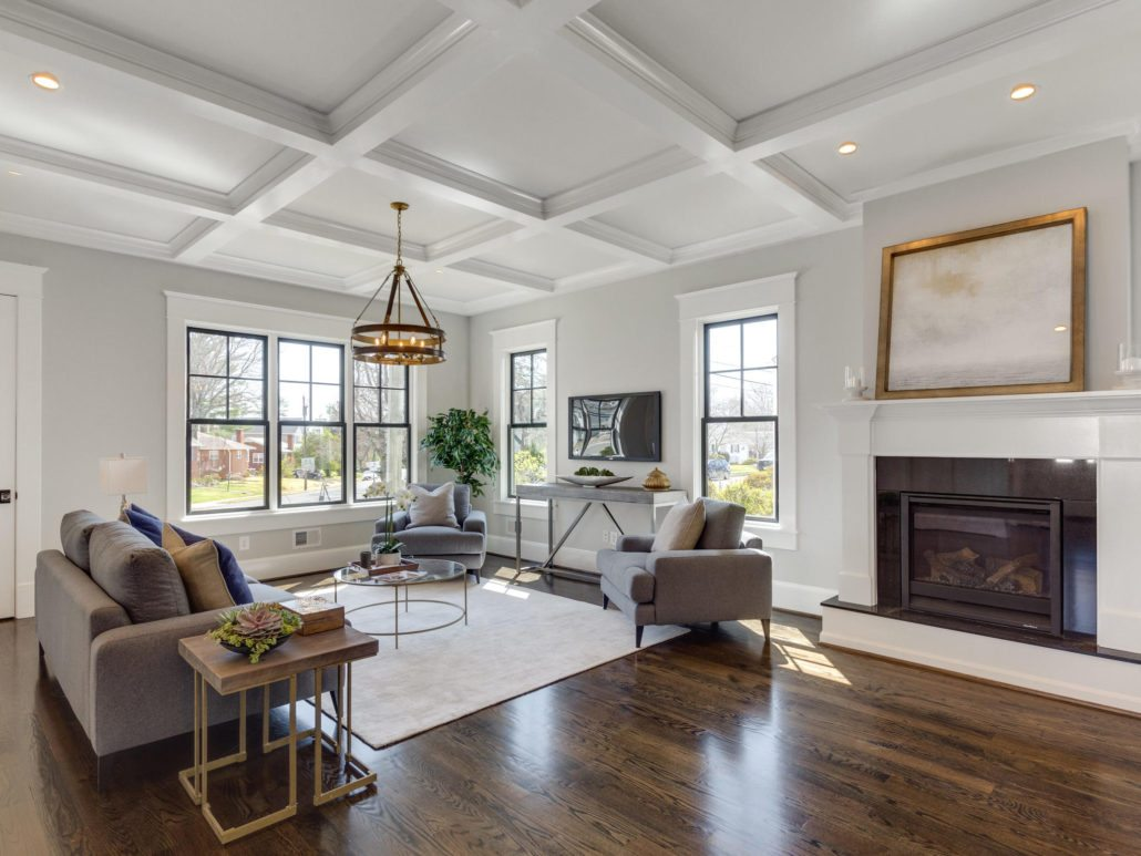 Family room with black framed windows and fireplace. Custom Home by Custom Builder, North Arlington, VA 22207