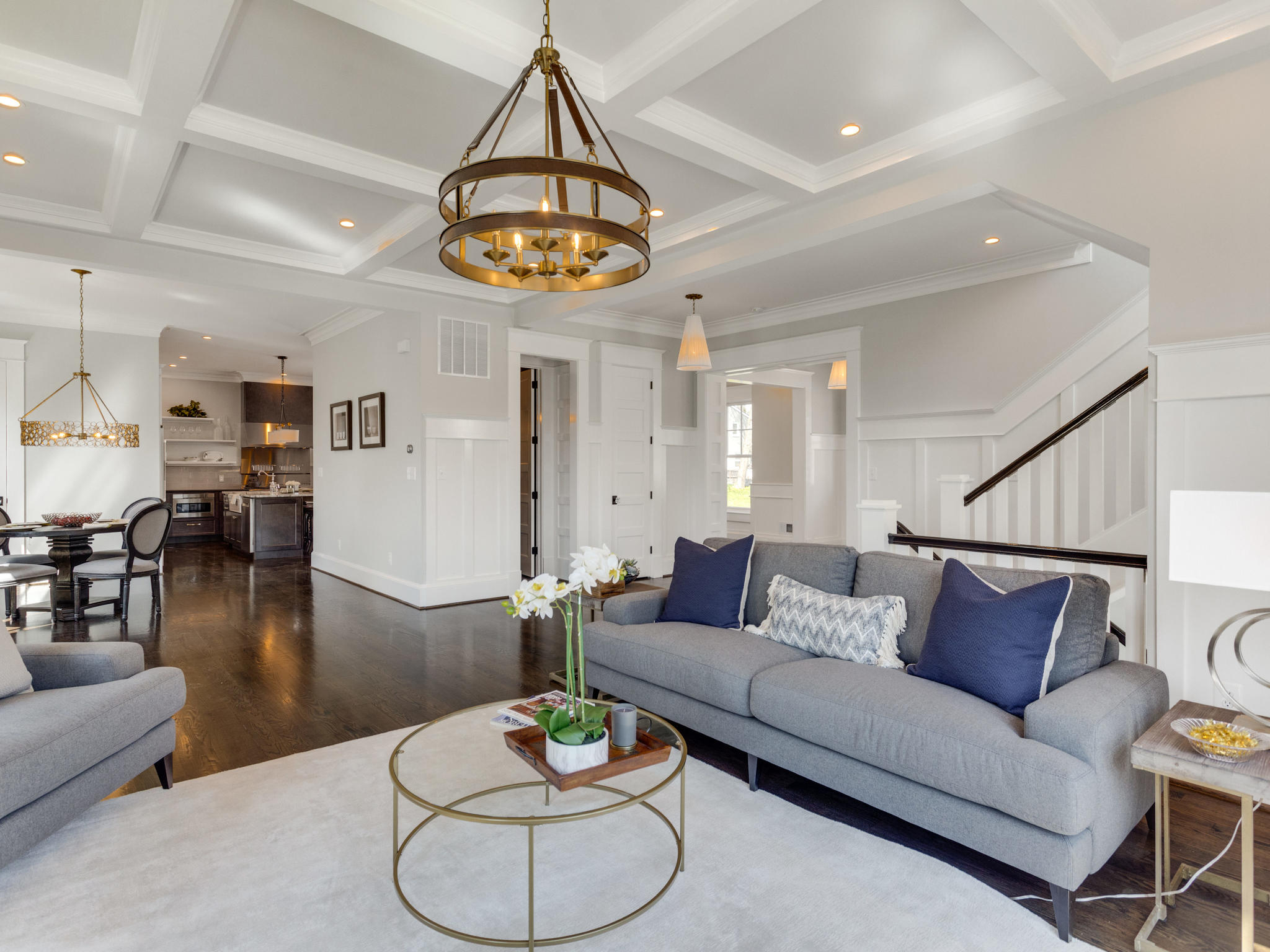 Family Room with coffered ceiling backs up to open staircase. Custom Home by Custom Builder, North Arlington, VA 22207