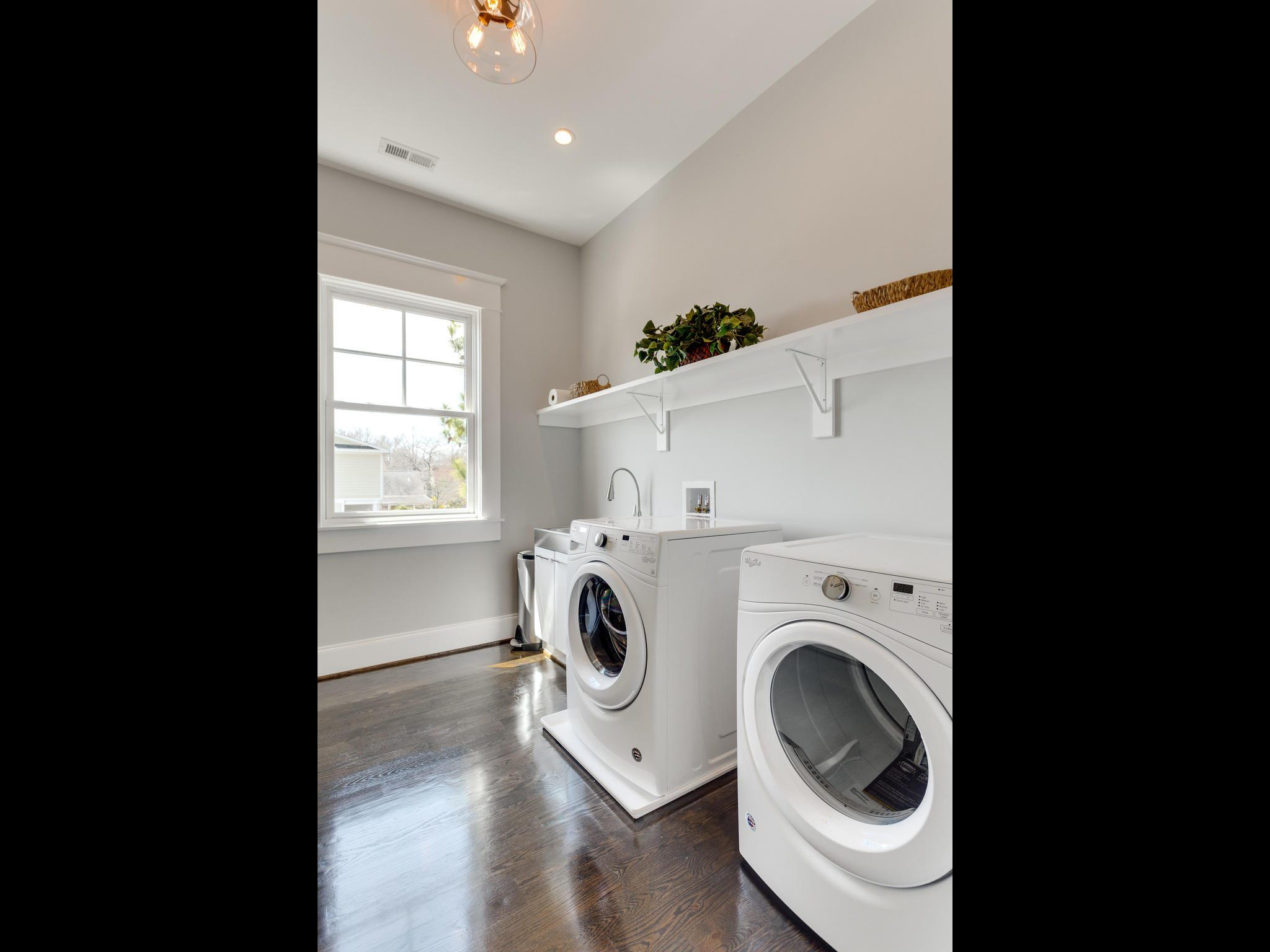 Upstairs laundry room. Custom Home by Custom Builder, North Arlington, VA 22207