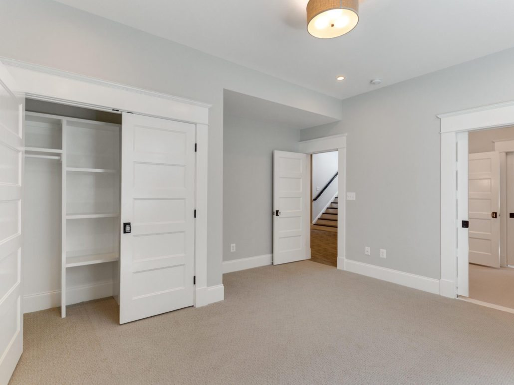 Basement bedroom with full size egress windows and closet with built ins. Custom Home by Custom Builder, North Arlington, VA 22207