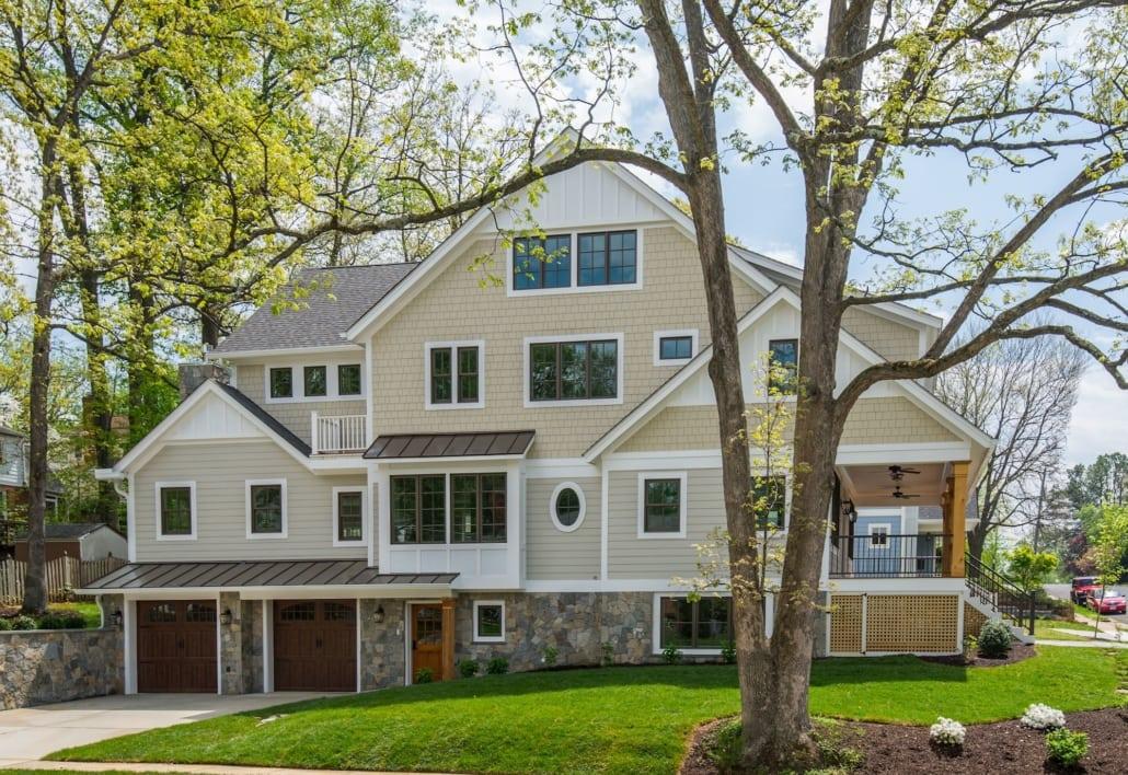 Side entrance garage and mix of stone, siding, and cedar exterior finishes. Custom Home by Custom Builder, North Arlington, VA 22207
