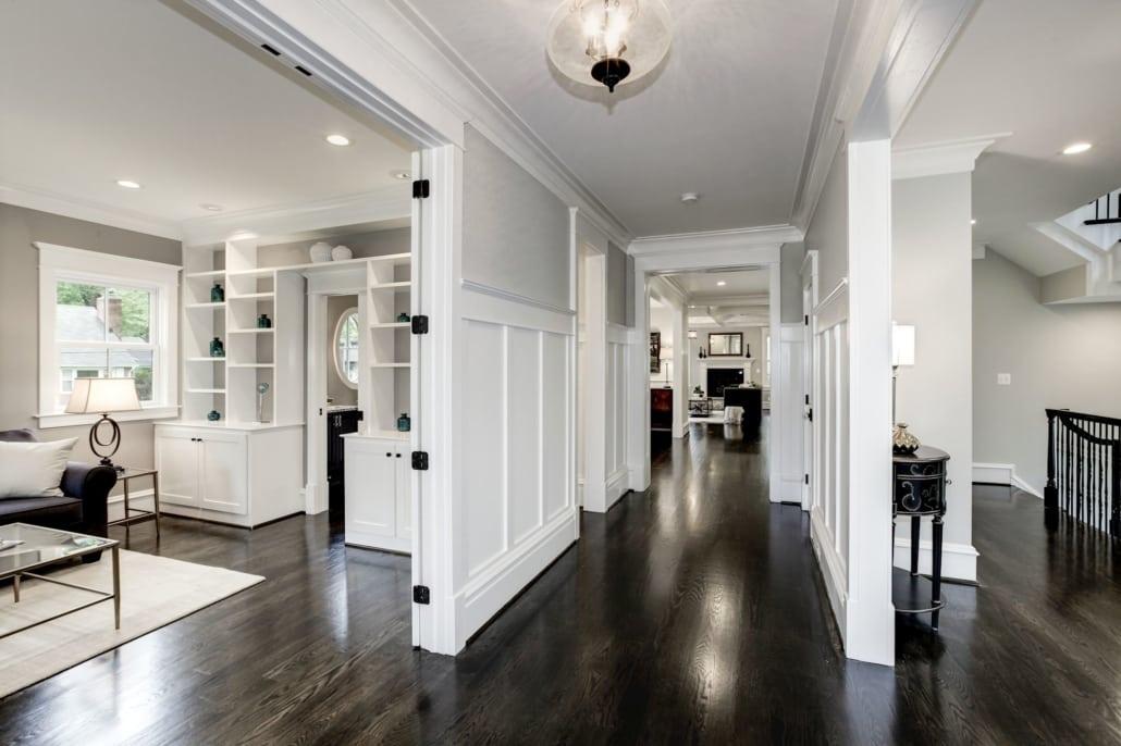 Front hall with gleaming hardwood, layers of custom paneling and trim work. Custom Home by Custom Builder, North Arlington, VA 22207