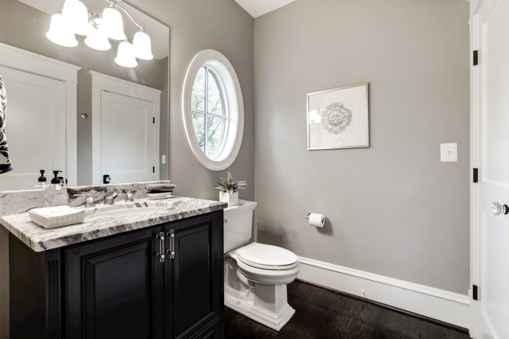 "First floor bath is both a powder room and a full bath with ""hidden"" shower. Custom Home by Custom Builder, North Arlington, VA 22207"
