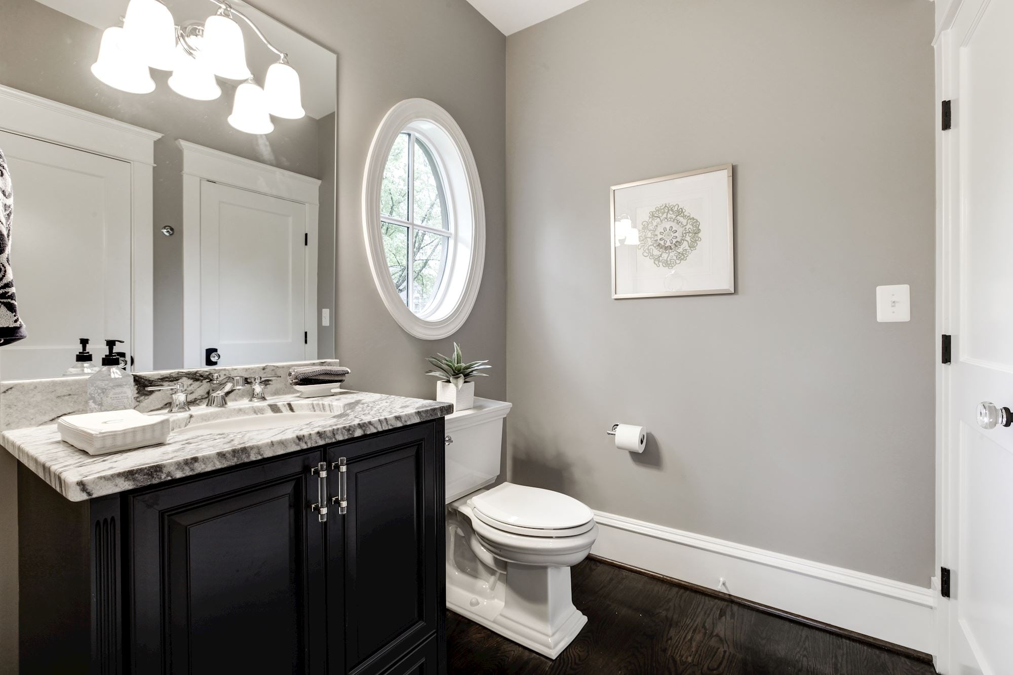 "First floor bath is both a powder room and a full bath with ""hidden"" shower. Custom Home by Custom Builder, North Arlington, VA 22207"