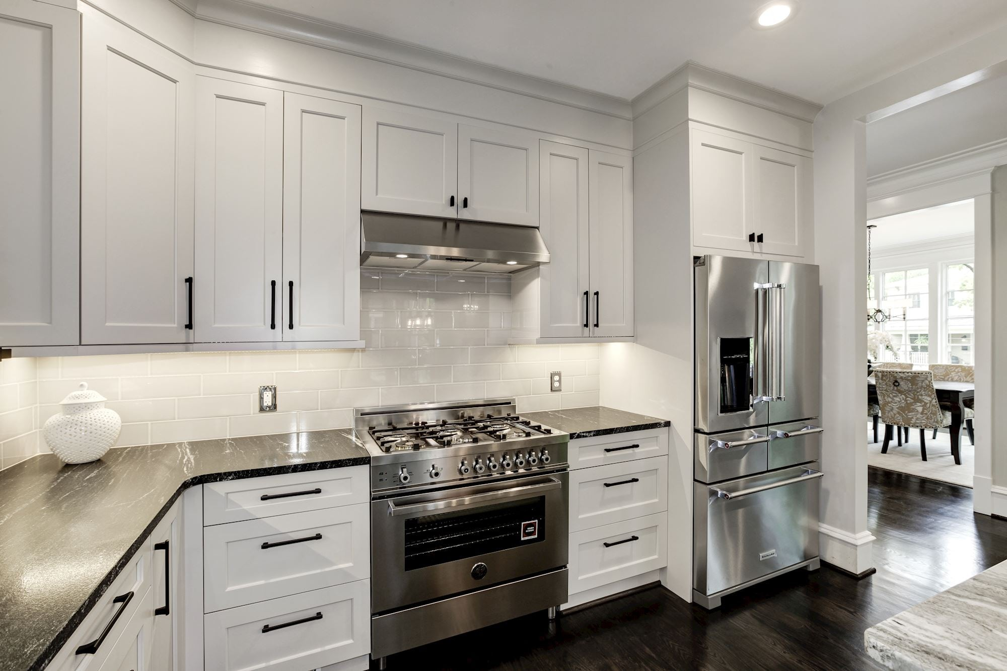 Kitchen with under counter lighting and white cabinetry. Custom Home by Custom Builder, North Arlington, VA 22207