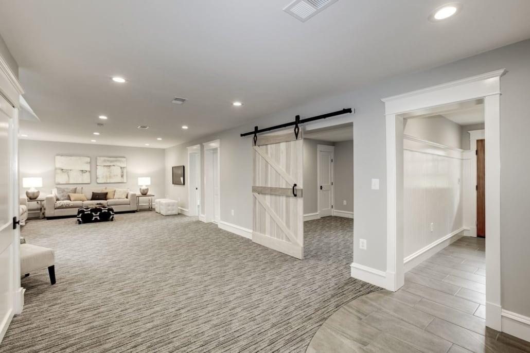 Lower level. Barn door leads to bonus room Custom Home by Custom Builder, North Arlington, VA 22207