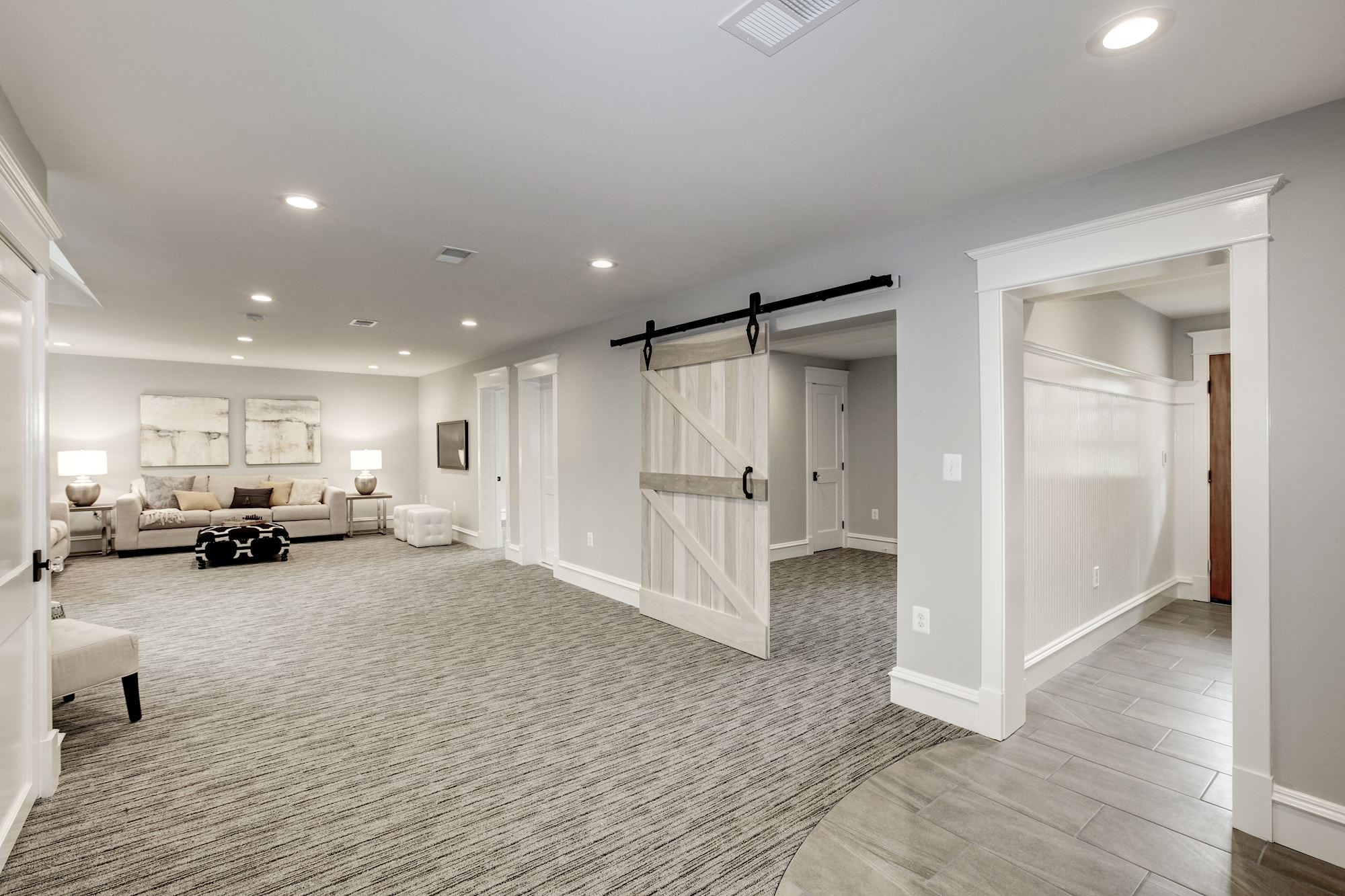 Lower level. Barn door leads to bonus room Custom Home by Custom Builder, North Arlington, VA 22207