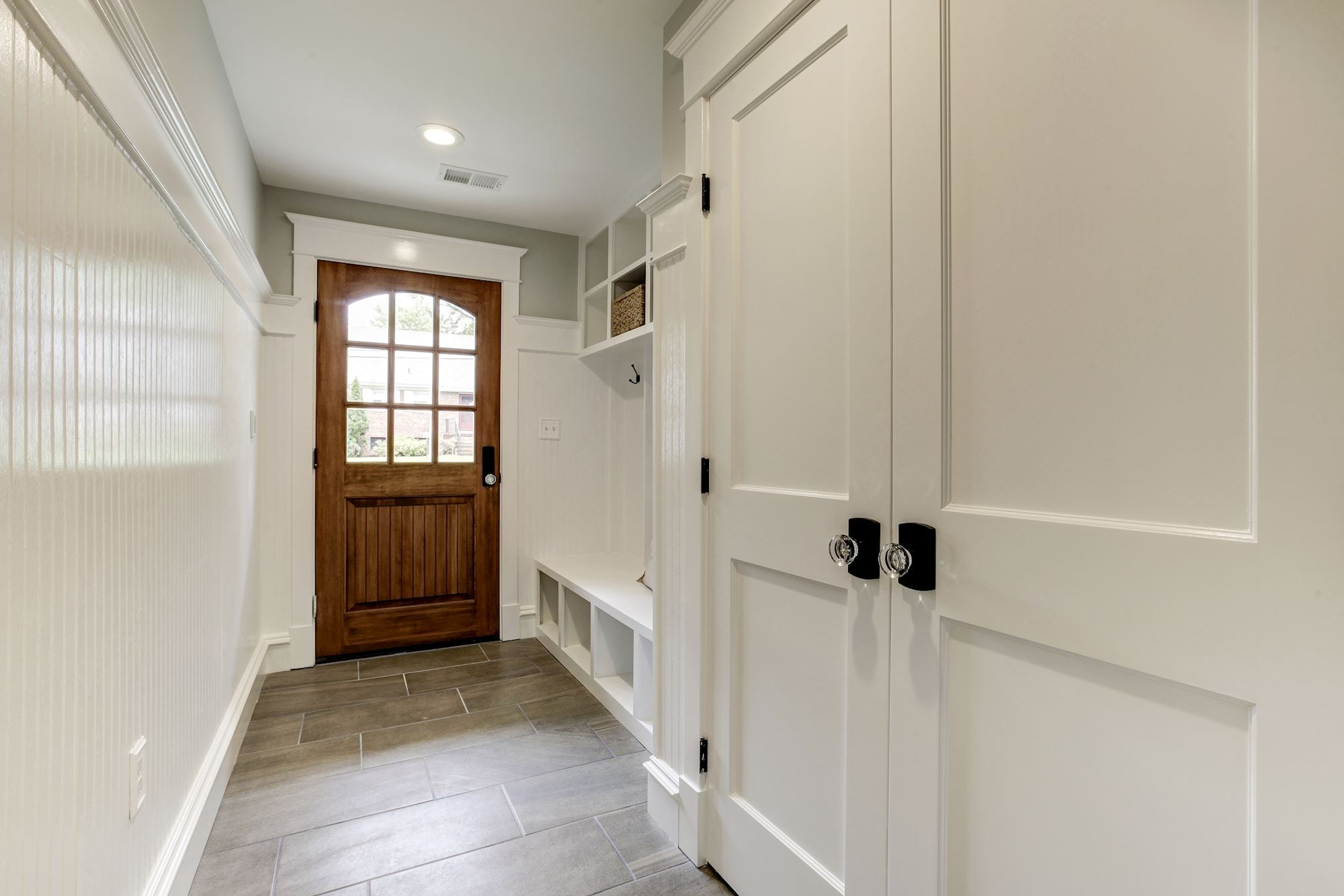 Lower level mud room leads to driveway and attached garage. Custom Home by Custom Builder, North Arlington, VA 22207