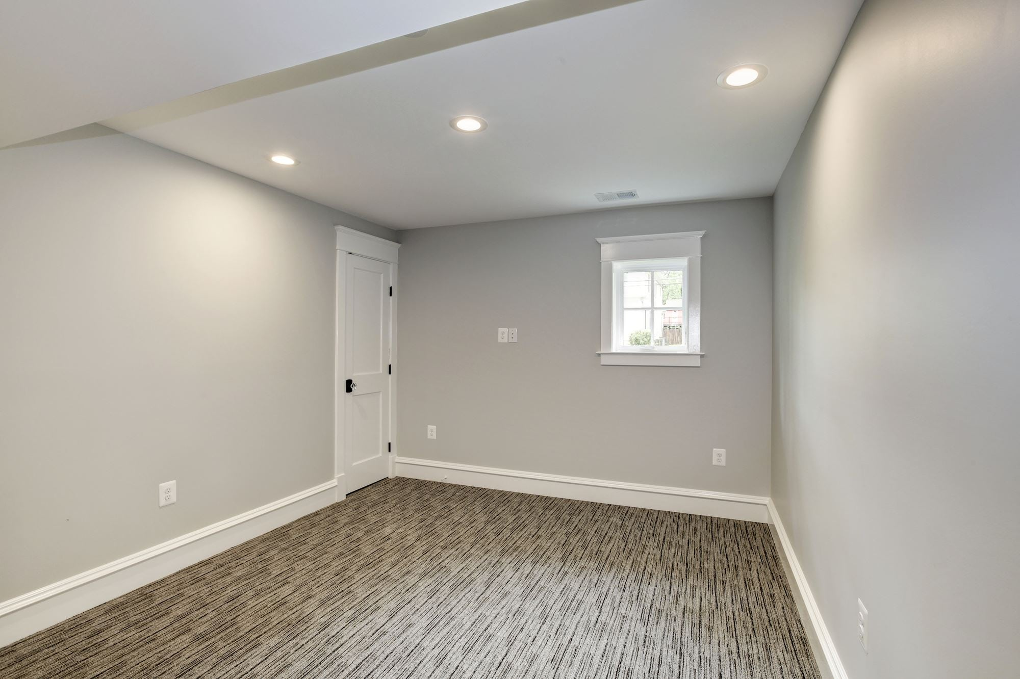 Lower level bonus room with window and closet. Custom Home by Custom Builder, North Arlington, VA 22207