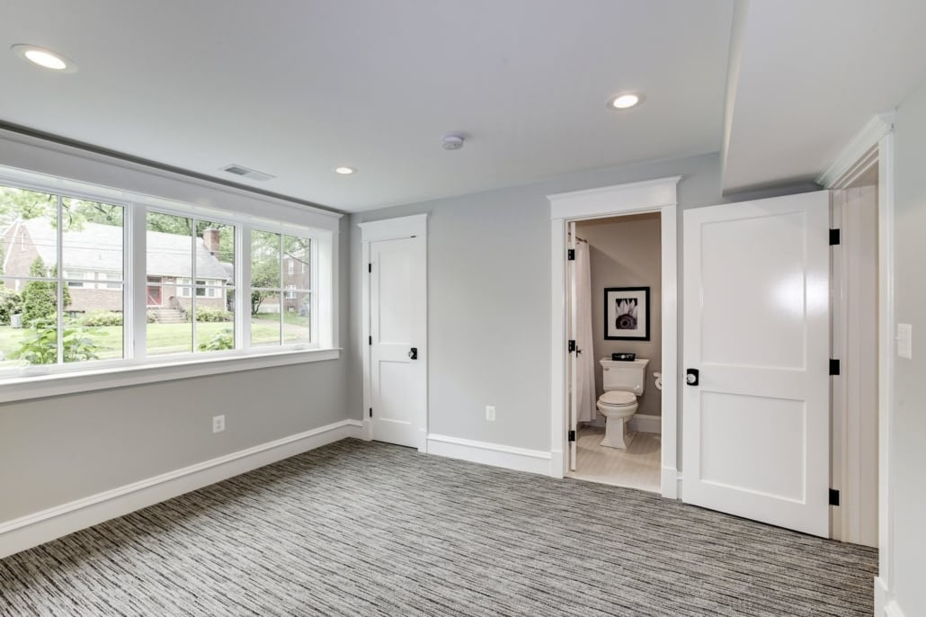 Lower level bedroom with egress window and entrance to full bath. Custom Home by Custom Builder, North Arlington, VA 22207