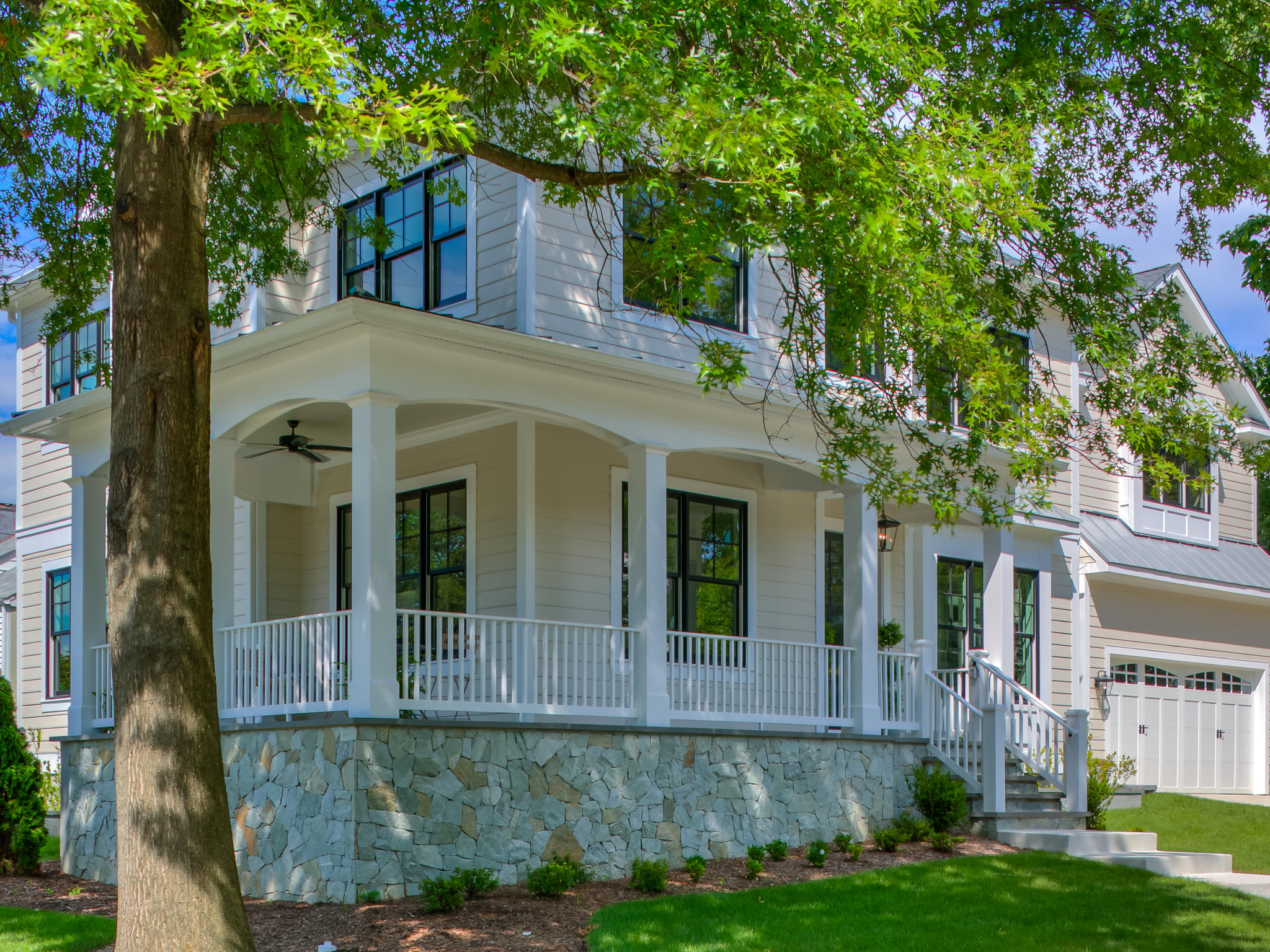 Wrap around porch in the shade of an old oak tree. Custom Home by Custom Builder, North Arlington, VA 22207