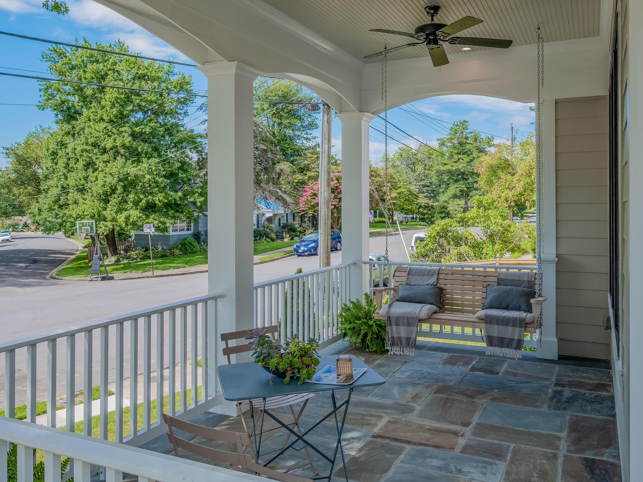 Pennsylvania stone patio with arched trim and beadboard ceiling. Custom Home by Custom Builder, North Arlington, VA 22207