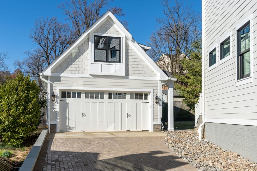 Double garage with upper floor above.