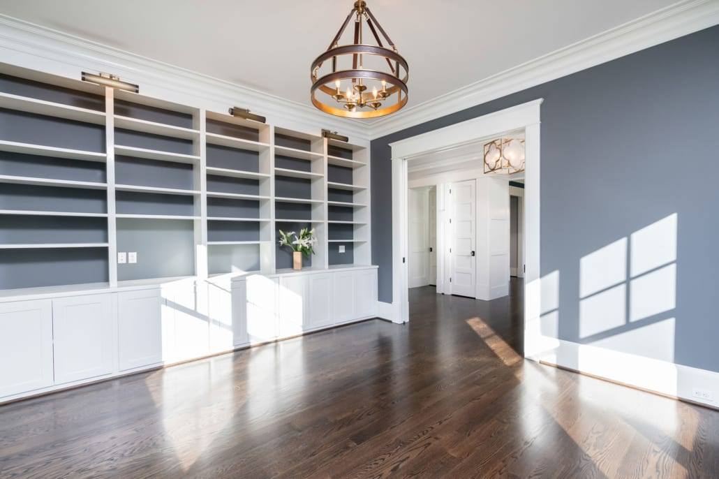 Spacious library with custom built-in cabinets.