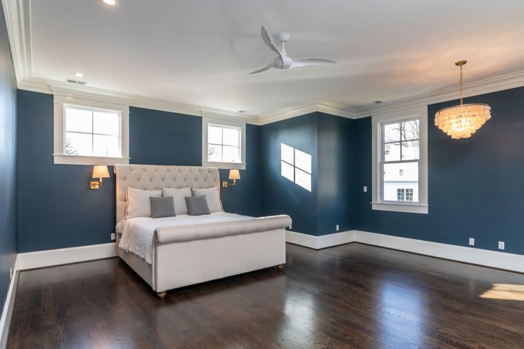 Spacious en suite Master bedroom with custom lighting.