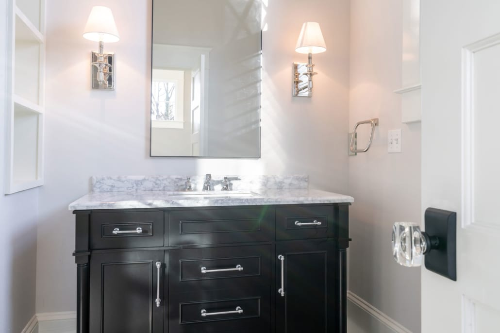 En Suite bath with black vanity. Notice the knob which is used throughout.