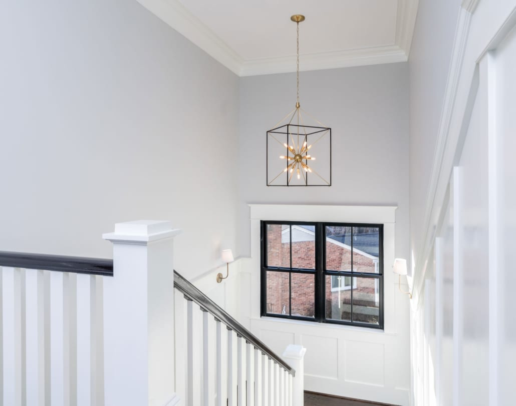 Upper Hall Stair with dramatic chandelier.