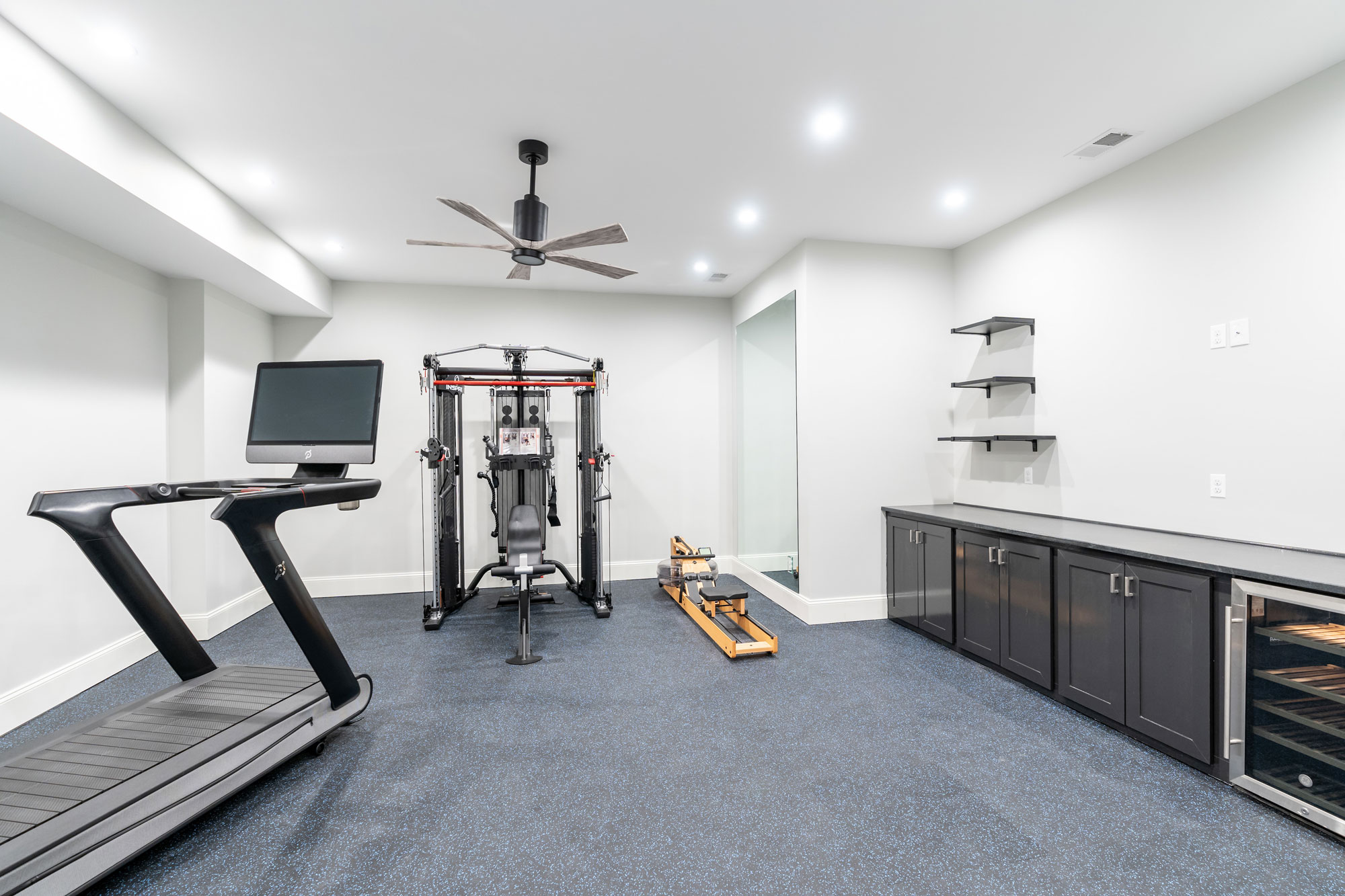 Family exercise gym with tech flooring and built ins.