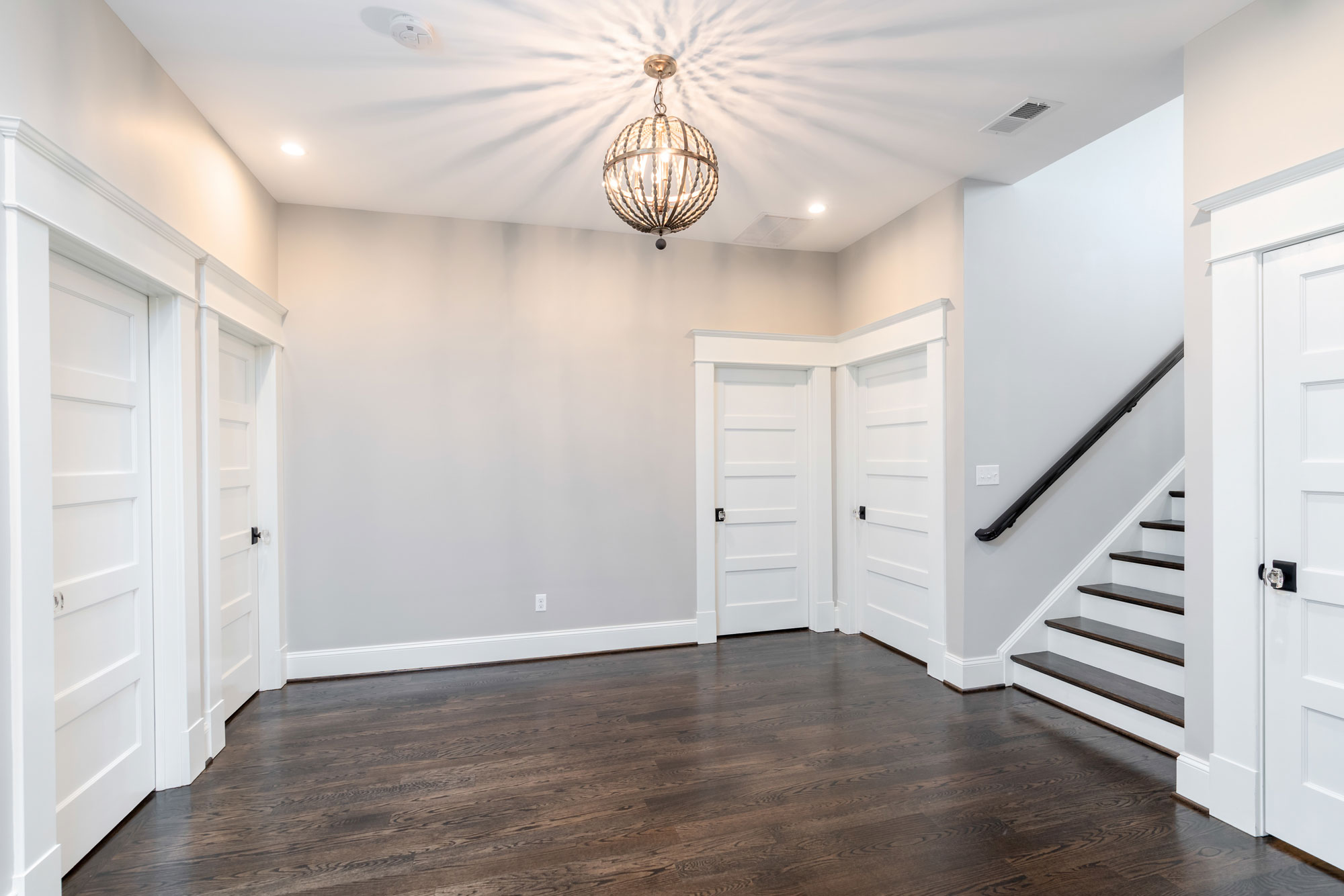 Hardwood floors on the basement landing.