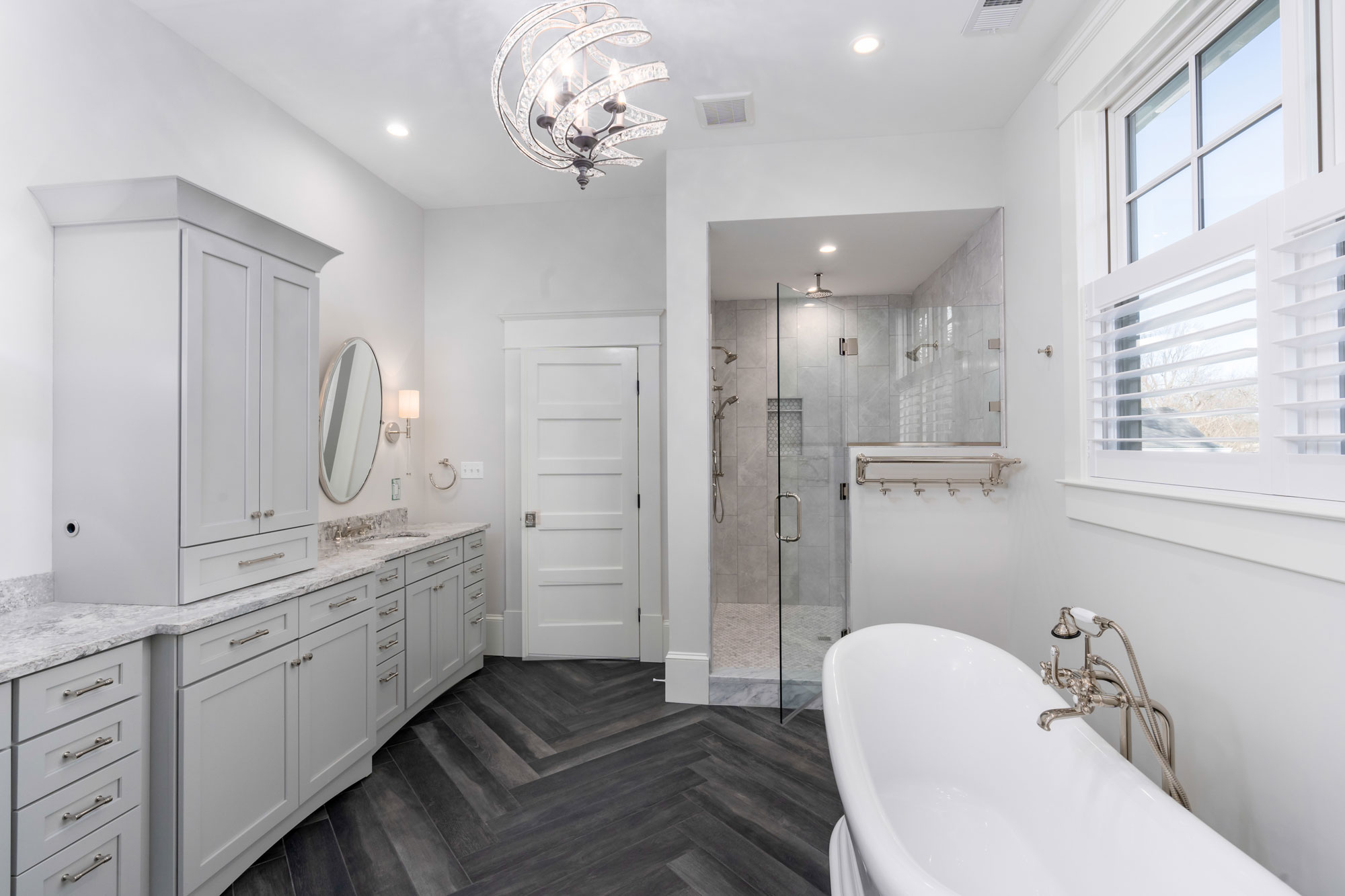 Master bath has a double thermostatic shower and free-standing tub. Heated tile floor.
