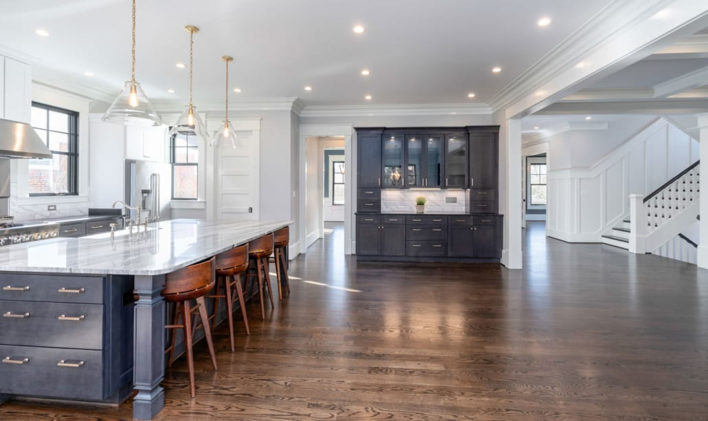 Extra cabinetry in the kitchen with twin towers and interior lighting in the uppers.