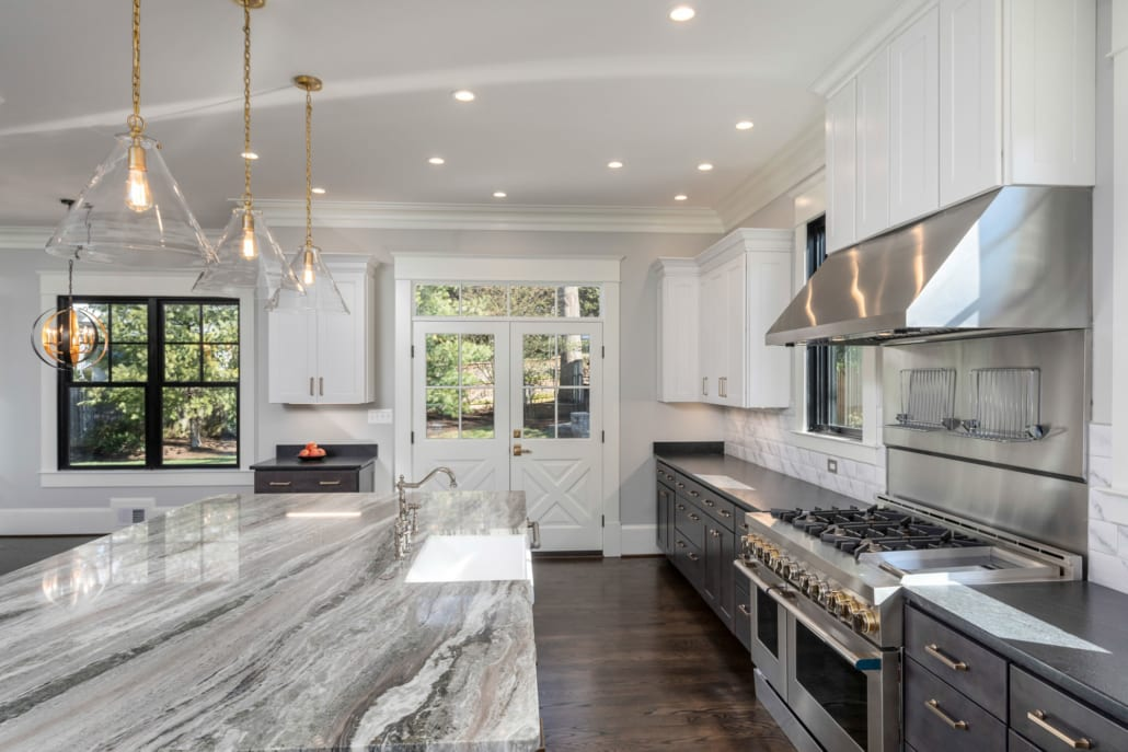 Leathered granite perimeter and marble topped island with professional appliances.