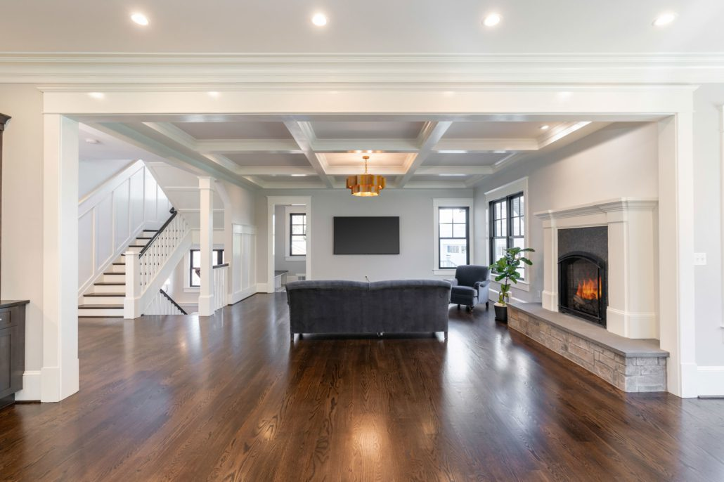 Spacious great room with kitchen, breakfast nook, and family room with coffered ceiling.