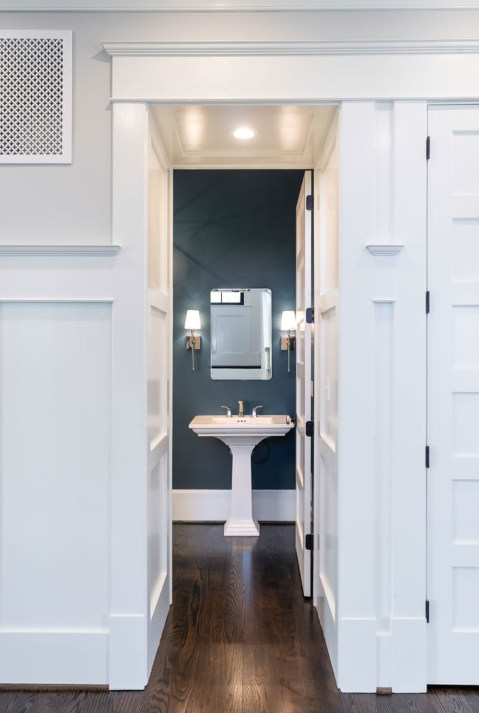 """A """"boxed"""" vestibule frames the entrance to the Powder Room."""